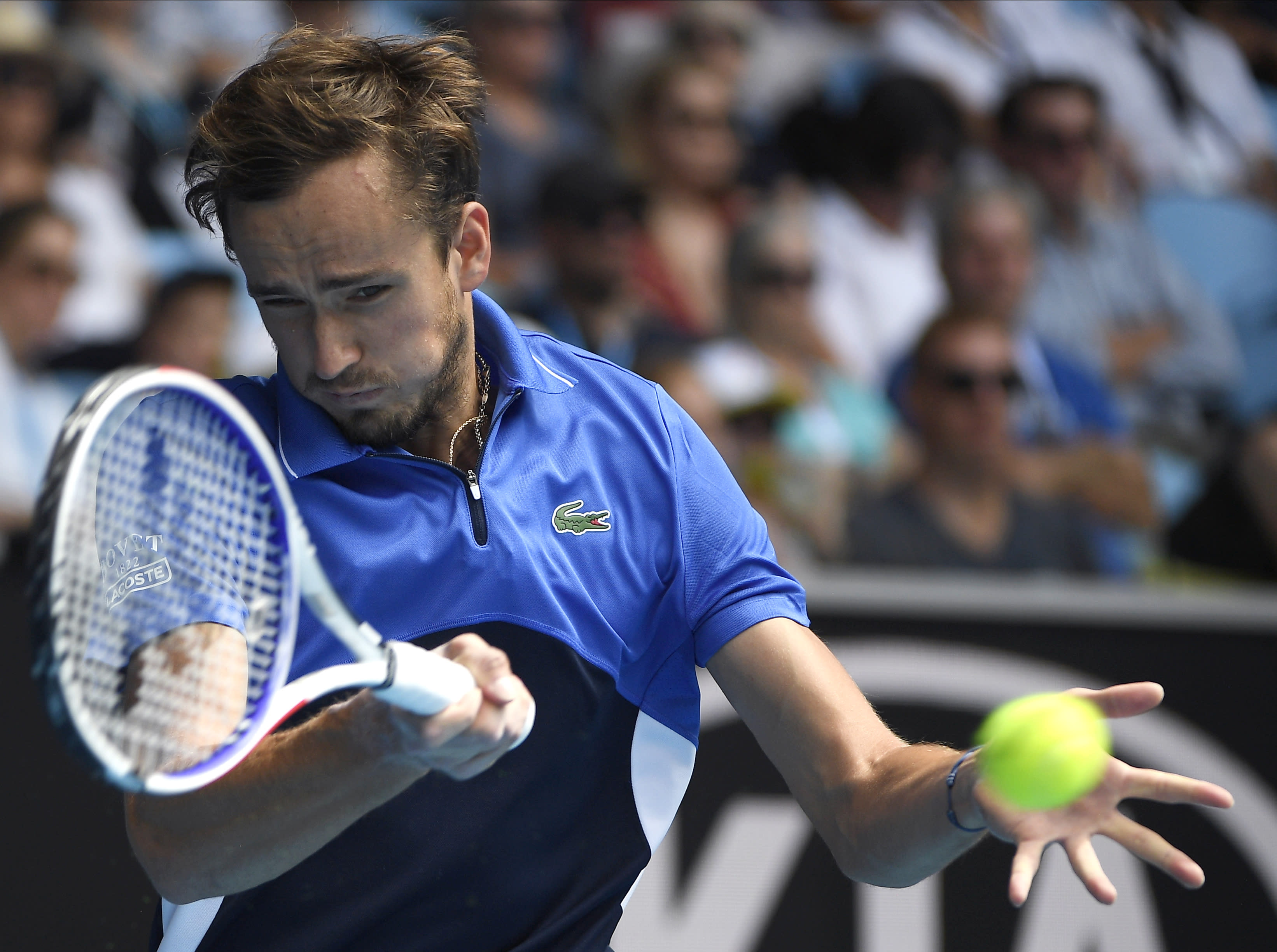 FILE - In this Jan. 27, 2020, file photo, Russia's Daniil Medvedev makes a forehand return to Switzerland's Stan Wawrinka during their fourth round singles match at the Australian Open tennis championship in Melbourne, Australia. Medvedev is scheduled to play in the U.S. Open, scheduled for Aug. 31-Sept. 13, 2020.(AP Photo/Andy Brownbill, File)
