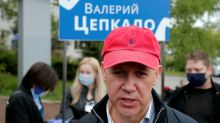 Belarus opposition leader flees abroad with two sons ahead of election