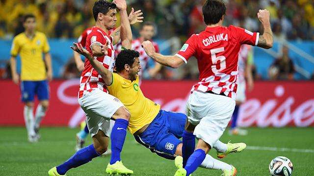 Penalty call boosts Brazil to World Cup opening win