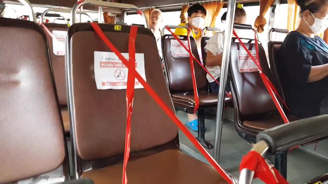 Thai bus seats blocked off with red tape to enforce COVID-19 ...