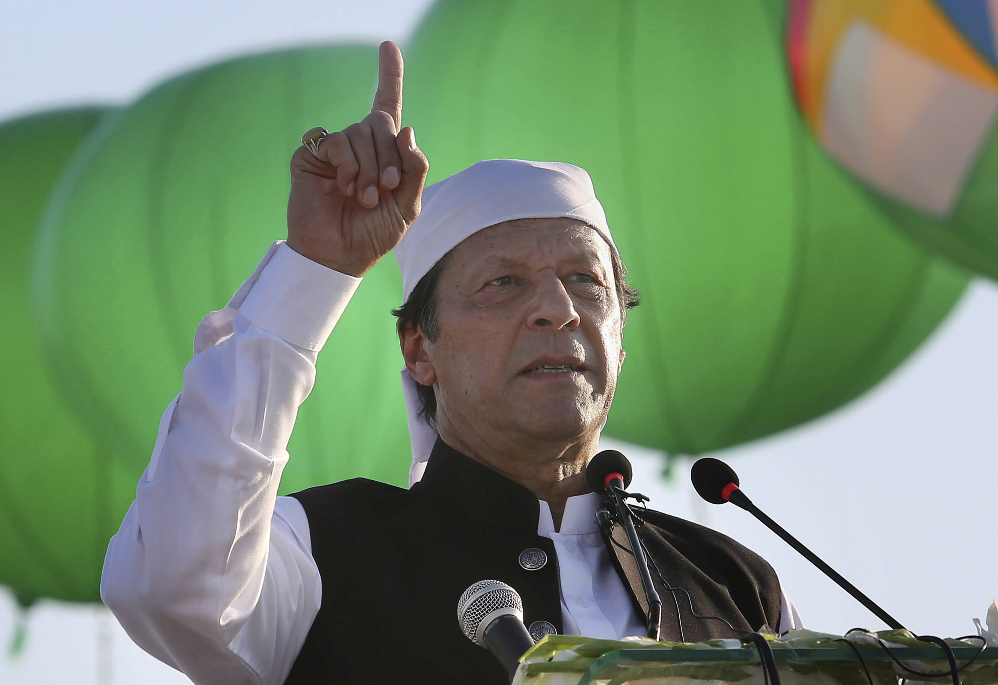 """FILE - In this Nov. 9, 2019 file photo, Pakistan Prime Minister Imran Khan addresses during the inauguration ceremony of Gurdwara Darbar Sahib in Kartarpur, Pakistan. Khan accused the United States on Thursday, June 25, 2020, of having """"martyred"""" al-Qaida leader and the mastermind of the 9/11 attacks, Osama bin Laden. (AP Photo/K.M. Chaudary,file)"""