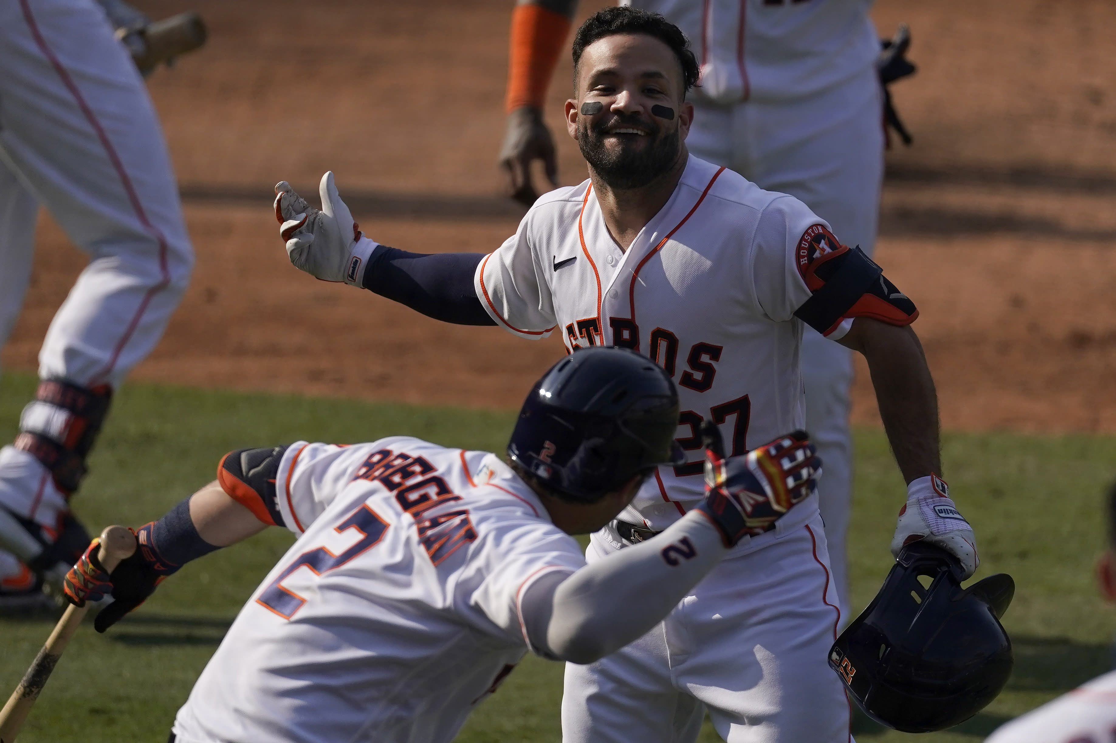 Houston Astros' Jose Altuve, top, is congratulated by Alex Bregman after hitting a two-run home run against the Oakland Athletics during the seventh inning of Game 4 of a baseball American League Division Series in Los Angeles, Thursday, Oct. 8, 2020. (AP Photo/Ashley Landis)