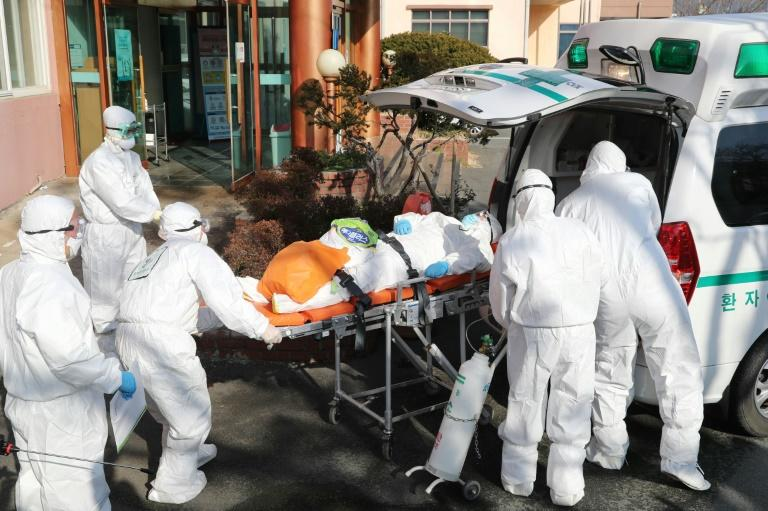 South Korea has the highest number of virus cases in the world outside China, where the disease first emerged in December and has since spread to dozens of countries (AFP Photo/-)