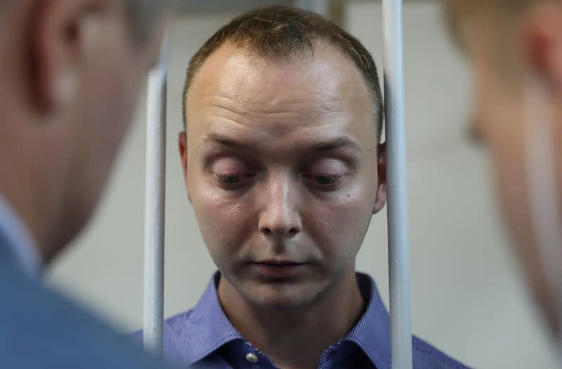 FILE PHOTO: Ivan Safronov, a former journalist who works as an aide to the head of Russia's space agency Roscosmos, detained on suspicion of treason, attends a court hearing in Moscow
