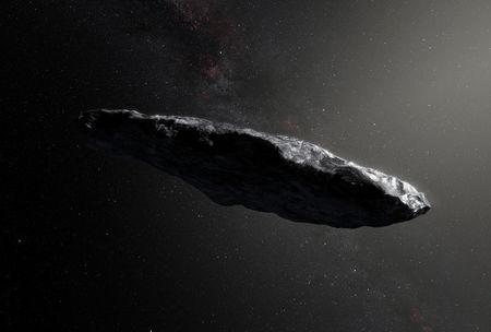 Handout photo of an artist's impression of the first interstellar asteroid `Oumuamua as it passes through the solar system after its discovery