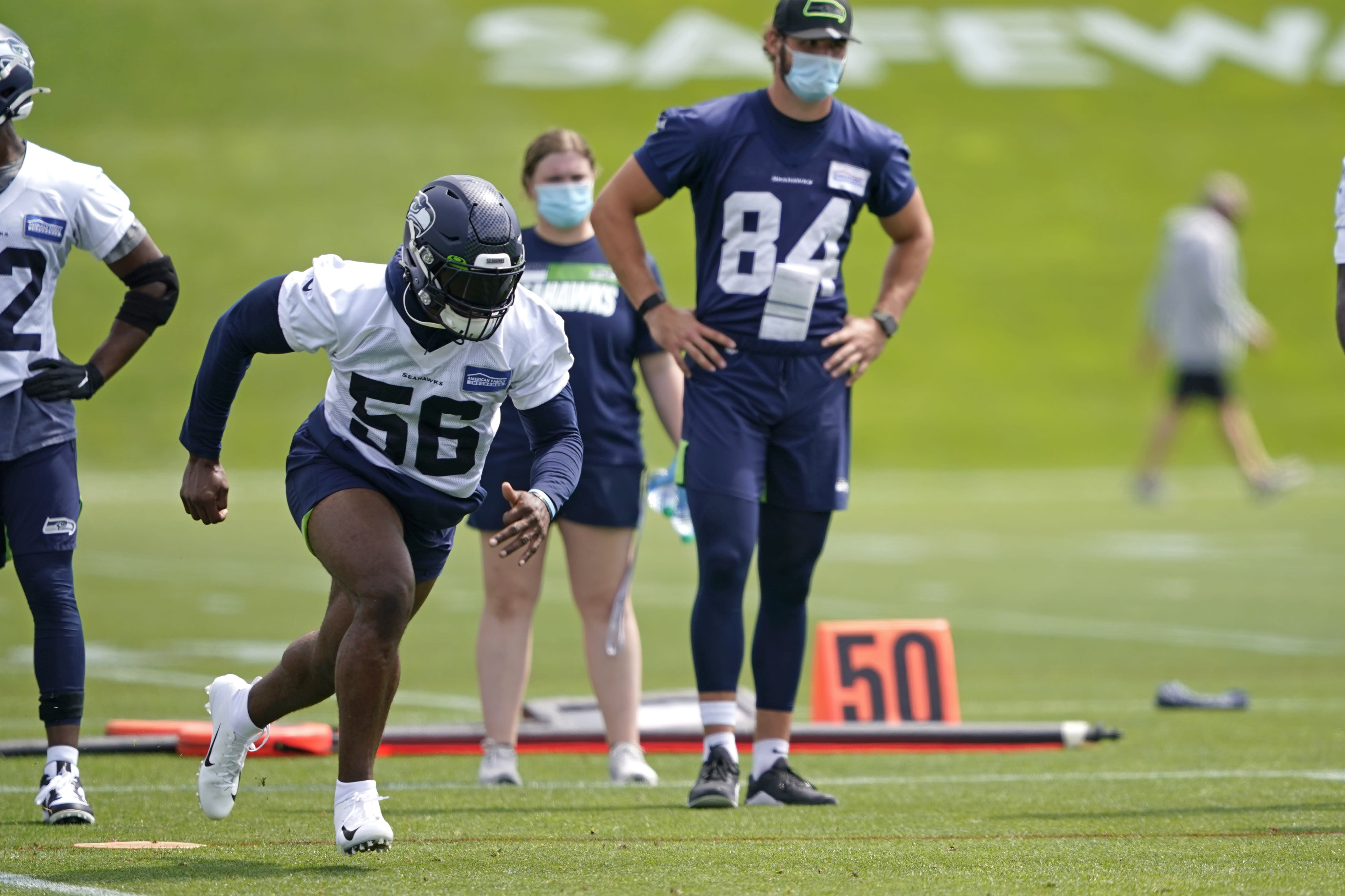 Seattle Seahawks linebacker Jordyn Brooks (56) runs a practice drill during NFL football training camp, Wednesday, Aug. 12, 2020, in Renton, Wash. (AP Photo/Ted S. Warren, Pool)