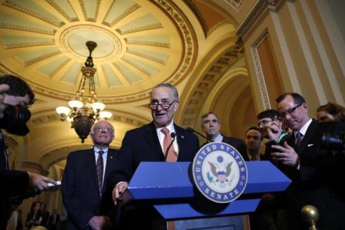 Senate Minority Leader Charles Schumer, Sen. Bernie Sanders, left, and Sen. Jeff Merkley