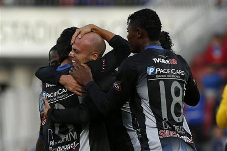 Figueroa celebrates with teammates from Ecuador's Emelec after scoring during Copa Sudamericana soccer match against Chile's Universidad de Chile in Santiago