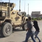 Kurds pelt U.S. troops with potatoes as they leave Syria; 'America is running away'