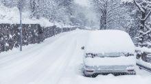 Woman Displeased to Find Car Filled With Snow After Leaving Window Open