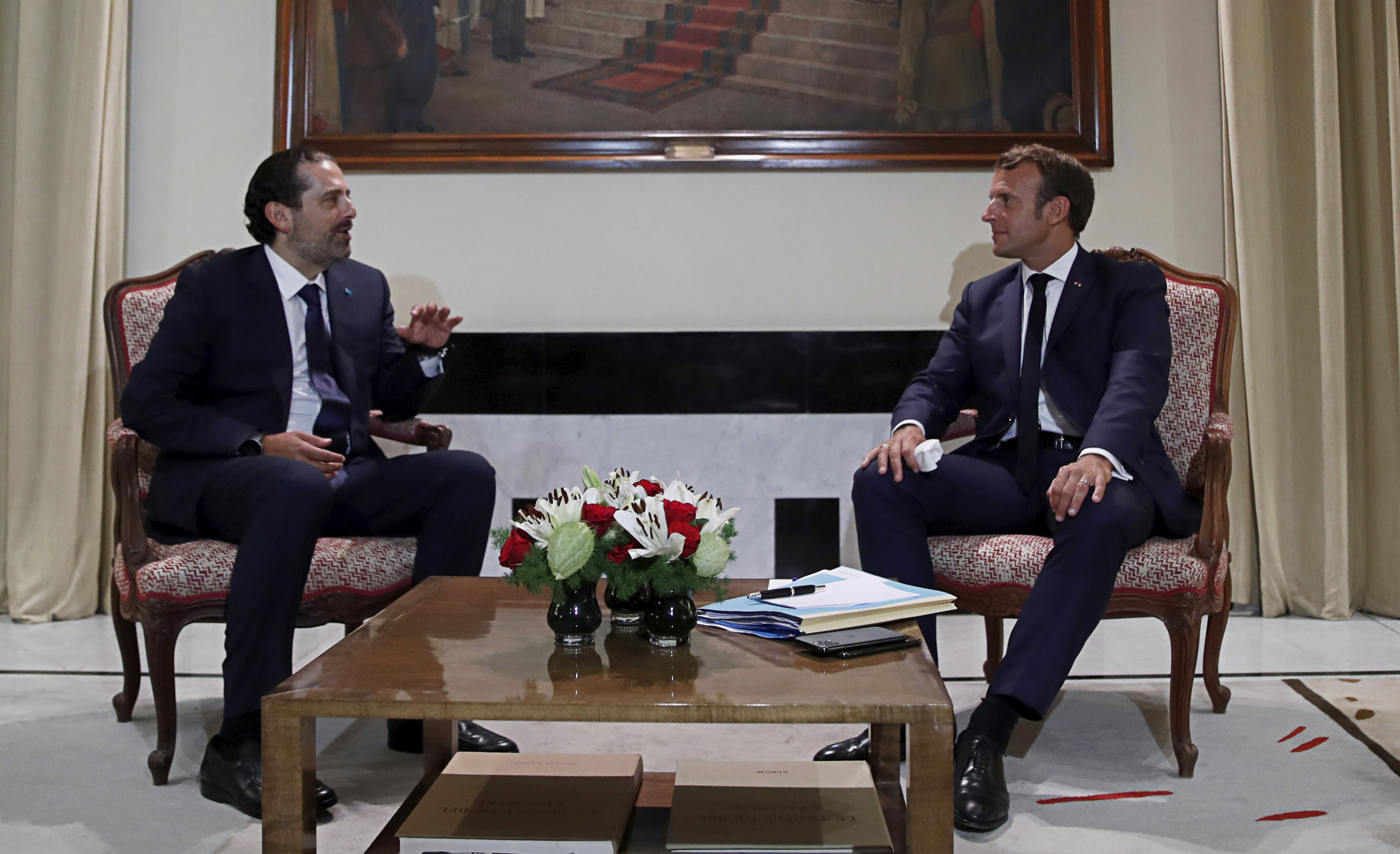 FILE - In this Aug. 31, 2020 file photo, French President Emmanuel Macron, right, meets former Lebanese Prime Minister Saad Hariri, in Beirut, Lebanon. During his visit last week, Macron gave Lebanon's politicians a road map for policy changes and reform, set deadlines for them to take action and told them he'd be back in December to check on progress. It was a hands-on approach that angered some in Lebanon and was welcomed by others. (Gonzalo Fuentes/Pool Photo via AP, File)