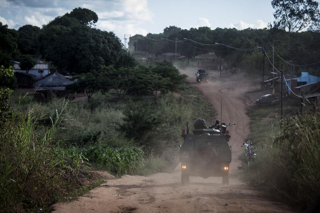 Mozambican regular army vehicles patrol the roads on the outskirts of Vanduzi village in the Gorongosa area, Mozambique (AFP Photo/JOHN WESSELS)