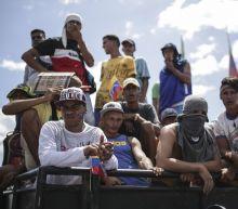 The Latest: Venezuelans demand aid at Brazil border