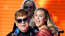 Unlikely friends Miley Cyrus and Elton John gush over each other after Grammys performance