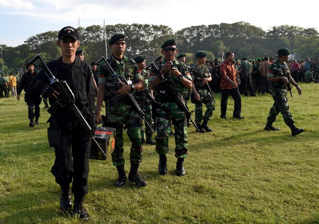 Soldiers gather for security prepartions in Denpasar on Indonesia's resort island of Bali, on June 23, 2017, ahead of a visit by former US president Barack Obama