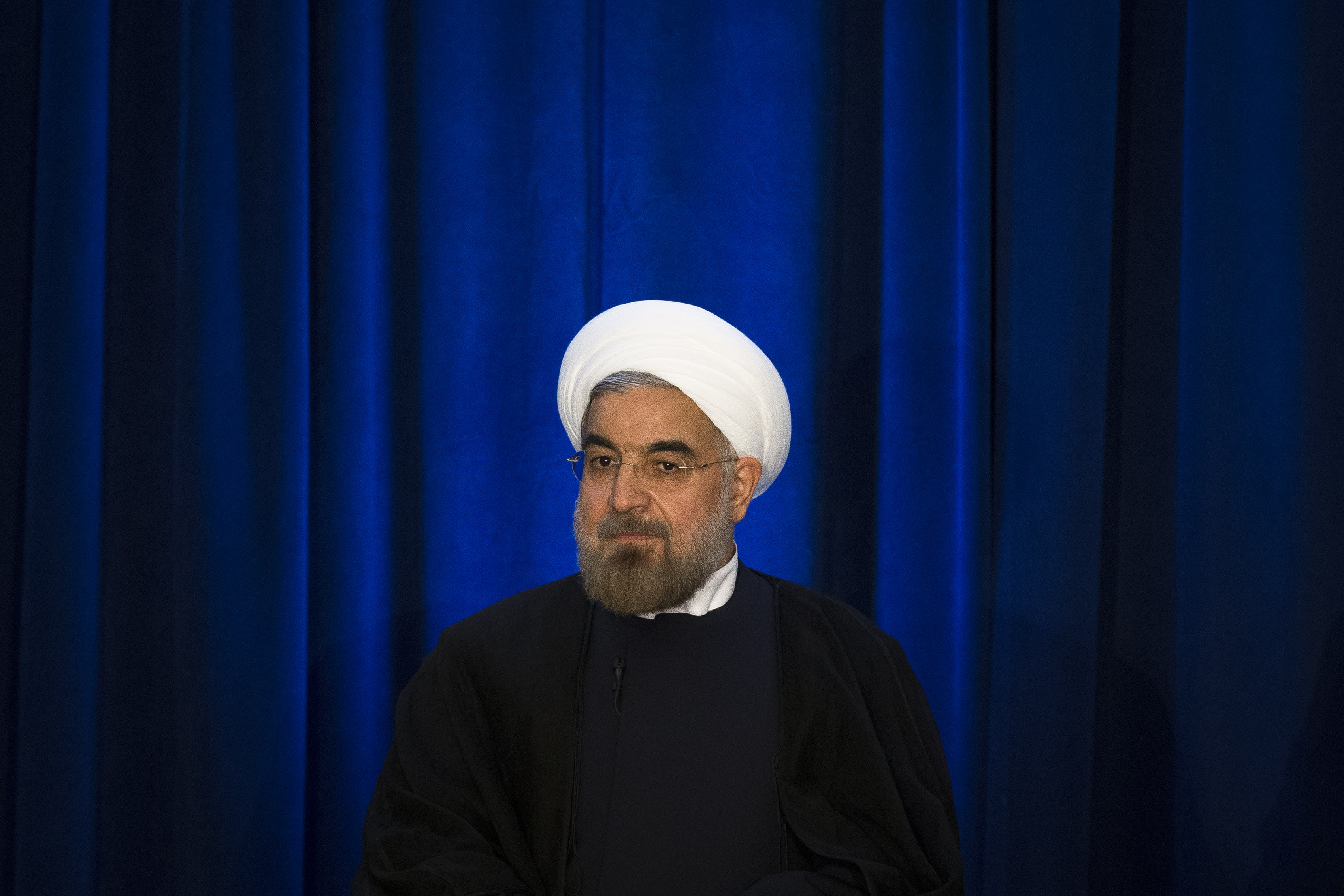 FILE - In this Sept. 26, 2013, file photo, Iranian President Hassan Rouhani waits to speak during an address and discussion hosted by the Asia Society and the Council on Foreign Relations at the Hilton Hotel in New York. The U.S. and Iran secretly engaged in high-level, face-to-face talks, at least three times over the past year, in a high stakes diplomatic gamble by the administration that paved the way for the historic deal aimed at slowing Iran's nuclear program. The last two meetings, held since Rouyhani was inaugurated in August, produced much of the agreement later hammered out in negotiations in Geneva. (AP Photo/John Minchillo, File)