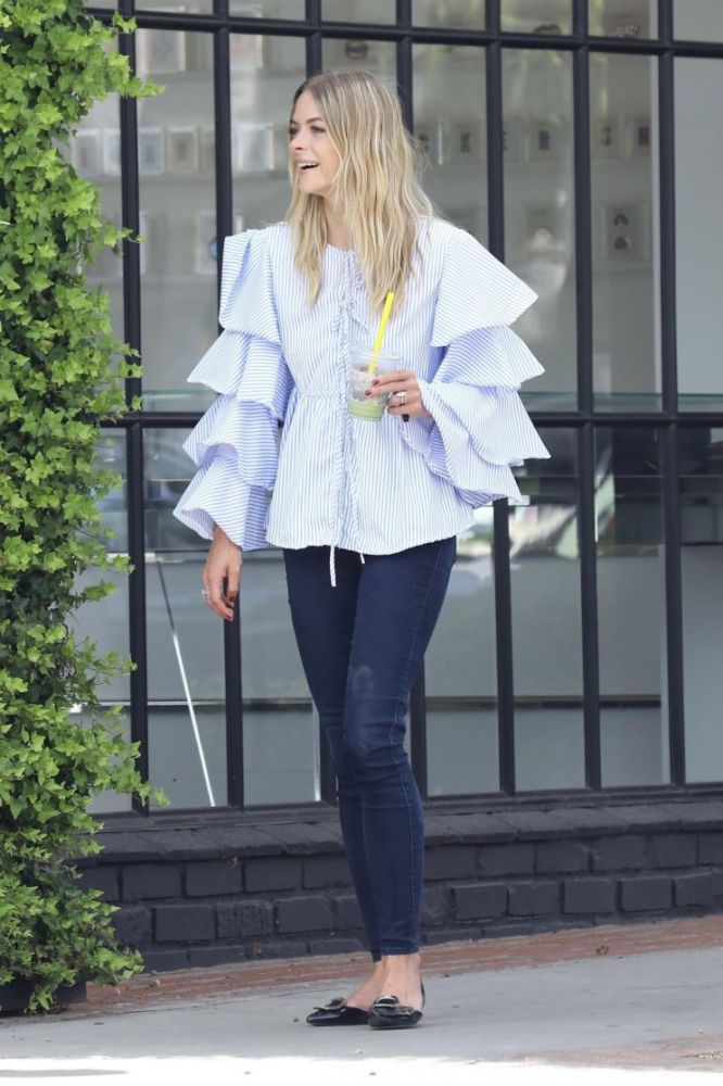 Jaime King wears a ruffled blouse from fast-fashion site SheIn.