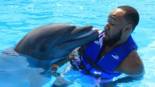 'Freaky' dolphin loves beards — and this viral photo is proof