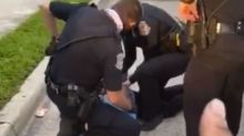 Florida police officer put on leave after pinning black man to the ground with knee