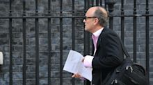 Cummings pictured in Downing Street with archive document on defence