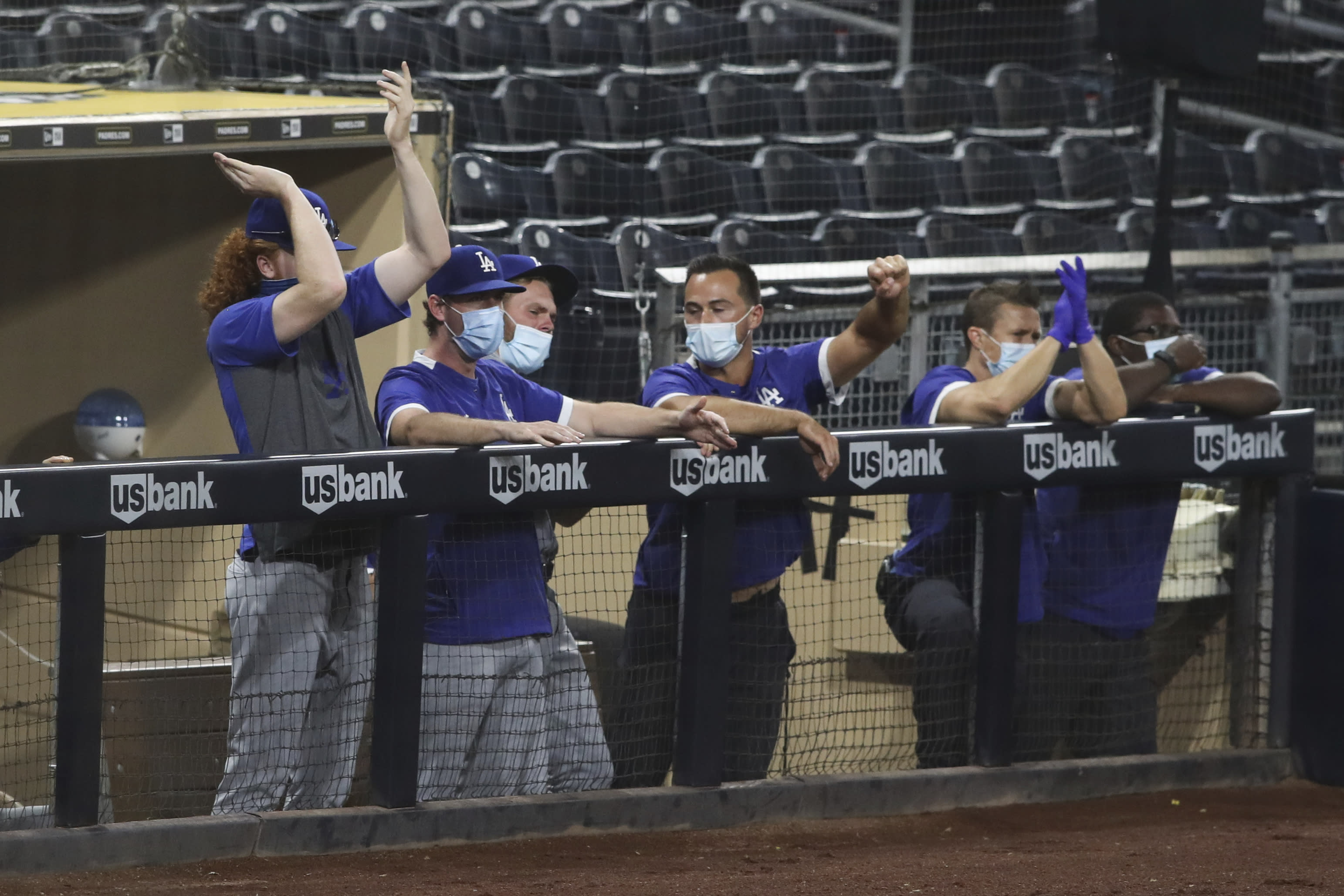 The Los Angeles Dodgers bench reacts after Edwin Rios hits a solo home run off San Diego Padres starting pitcher Zach Davies in the fifth inning of a baseball game Tuesday, Sept. 15, 2020, in San Diego. (AP Photo/Derrick Tuskan)