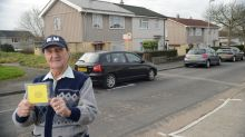 Ex-Marine fed-up with neighbours' parking hands out yellow HOMEMADE 'penalty tickets'