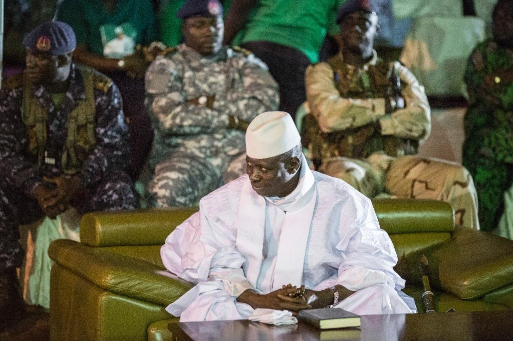 The regime of former president Yahya Jammeh (C) is accused by human rights defenders of systematically torturing political opponents and journalists, extrajudicial executions, arbitrary detentions and enforced disappearances (AFP Photo/MARCO LONGARI)