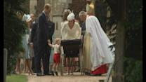 Prince George peers into baby sister's pram at christening