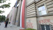 Under fire over LGBT rights, Polish leader blames activist