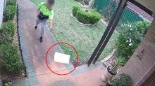 Postman caught throwing parcel 'like a frisbee' at front door