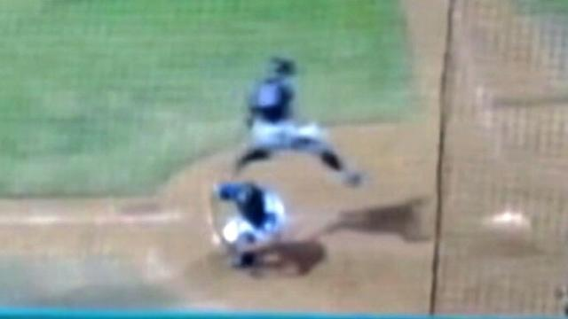 Baseball Player Jumps Over Catcher to Score