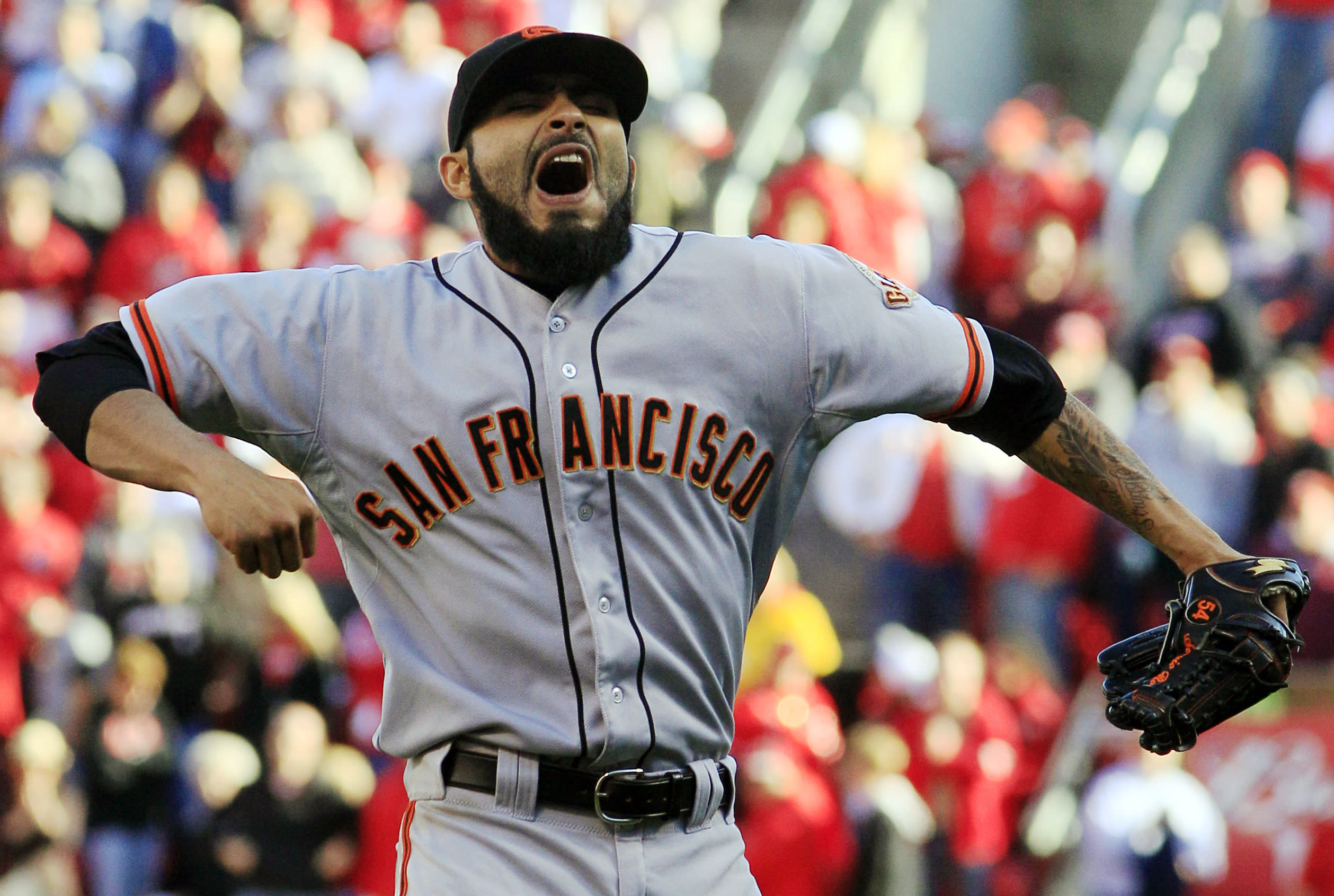 San Francisco Giants relief pitcher Sergio Romo celebrates after the Giants defeated the Cincinnati Reds 6-4 in Game 5 of the National League division baseball series, Thursday, Oct. 11, 2012, in Cincinnati. The Giants won the final three games, all in Cincinnati, and advanced to the NL championship series. (AP Photo/Al Behrman)