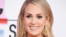 Carrie Underwood Debuts Baby Bump On The AMAs Red Carpet