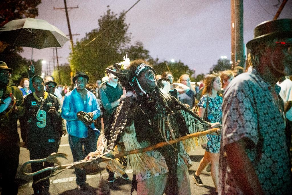 A Mardi Gras participant sings during the Second Line for the late Fats Domino in the 9th Ward of New Orleans, Louisiana (AFP Photo/Emily KASK)