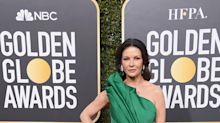 Catherine Zeta-Jones turns heads on the red carpet in emerald gown with thigh-high slit