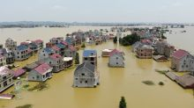 China to offer more financial support for flood-hit areas