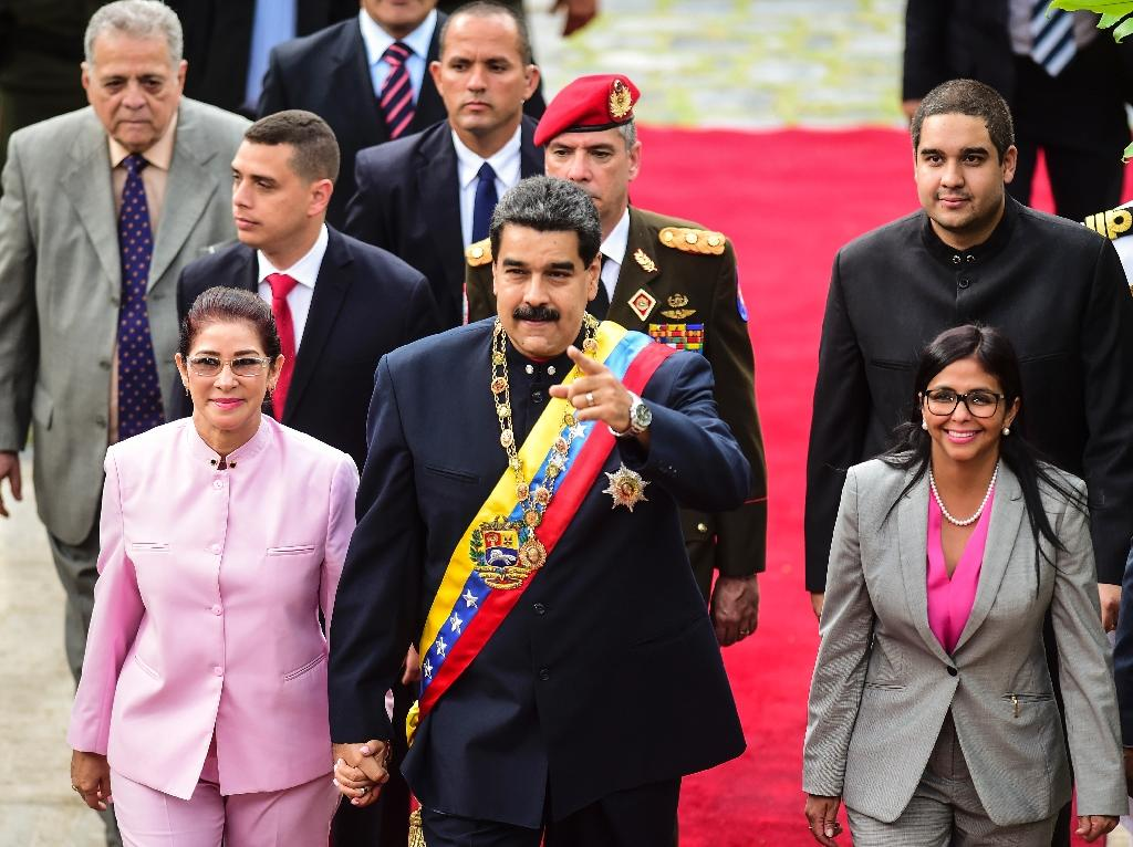 """Speaking to a new, all-powerful loyalist assembly he saw installed through elections last month, Maduro said he had instructed his foreign minister to set it up """"so I have a personal conversation with Donald Trump."""" (AFP Photo/Ronaldo SCHEMIDT)"""