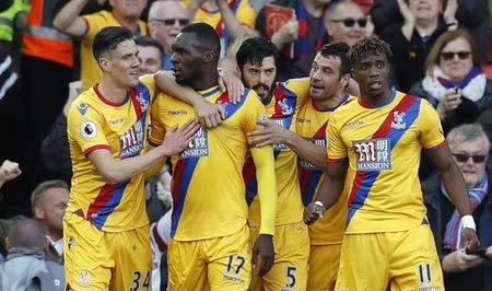 Crystal Palace's Christian Benteke celebrates scoring their second goal with team mates