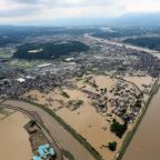 Japan floods: 'Unprecedented rainfall' leaves at least 15 dead and houses swept away amid devastating landslides
