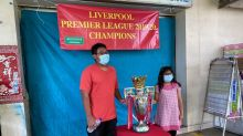 Liverpool fans enjoy lifting replica EPL trophy in Singapore, thanks to die-hard Red