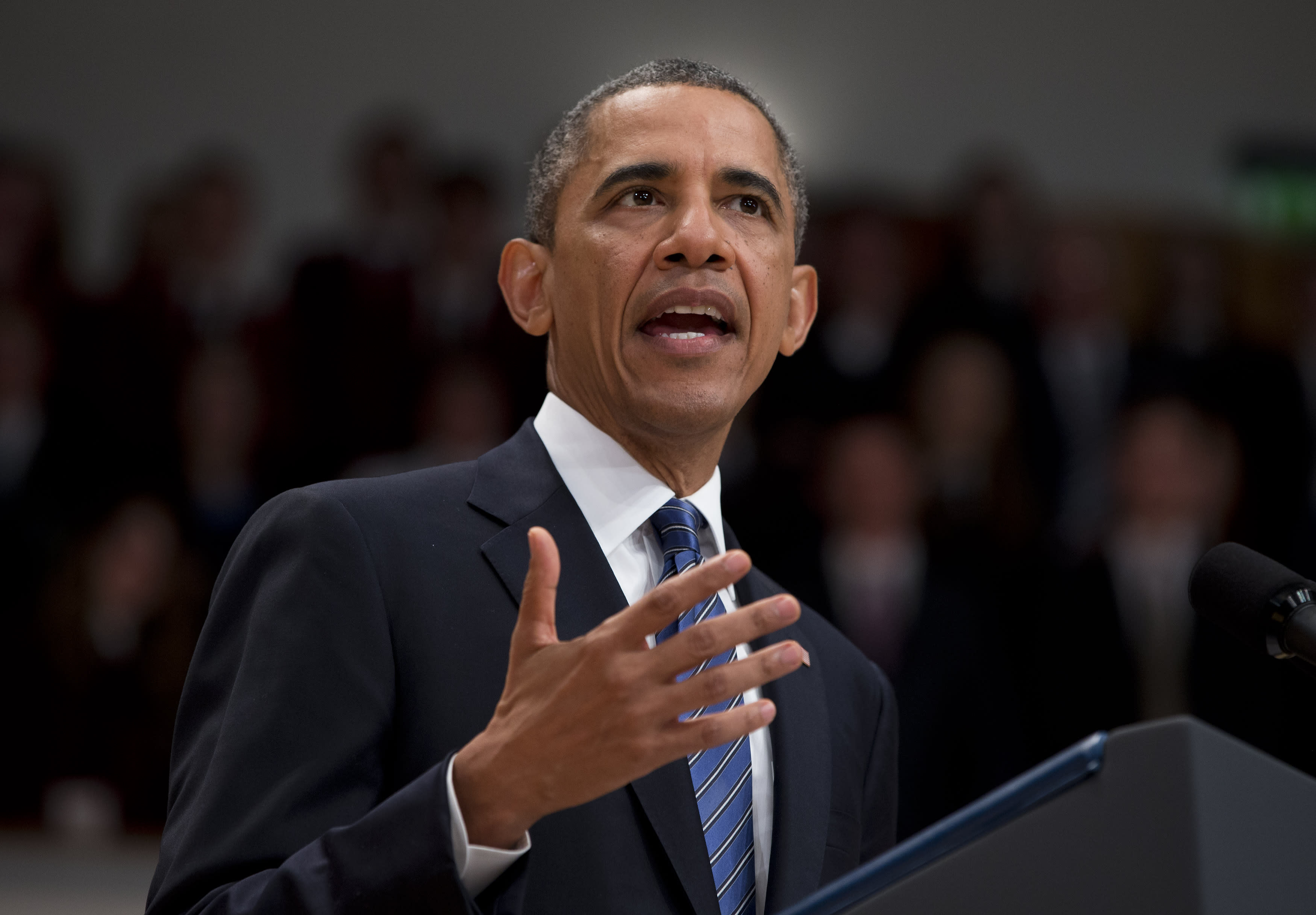 U.S. President Barack Obama gestures during a speech at the Belfast Waterfront on Monday, June 17, 2013, in Belfast, Northern Ireland. Obama is attending the G-8 summit in Enniskillen, Northern Ireland where leaders are expected to discuss the ongoing conflict in Syria, and free-trade issues. (AP Photo/Evan Vucci)