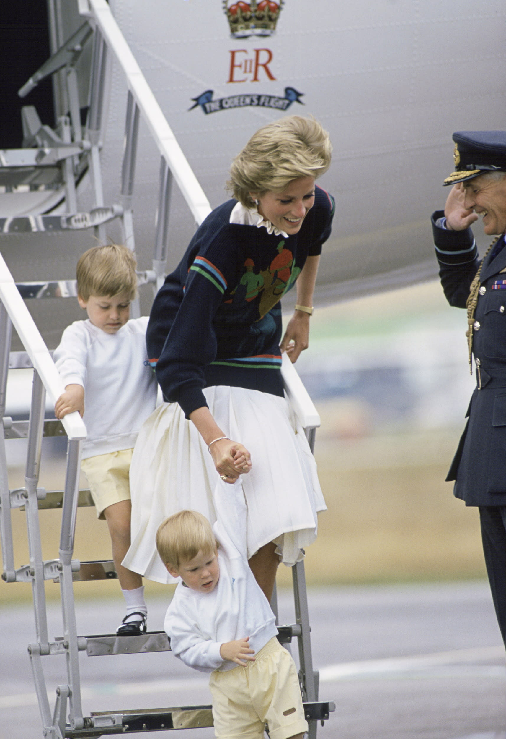 UNITED KINGDOM - AUGUST 16:  Princess Diana Stepping Off A Royal Flight With Her Sons Prince William And Prince Harry At Aberdeen Airport At The Start Of Their Holiday.  Her Jumper Has A Motif Of A Polo Player  (Photo by Tim Graham/Getty Images)