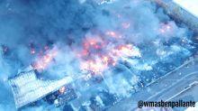 Fire service specialists probe cause of plastics factory blaze