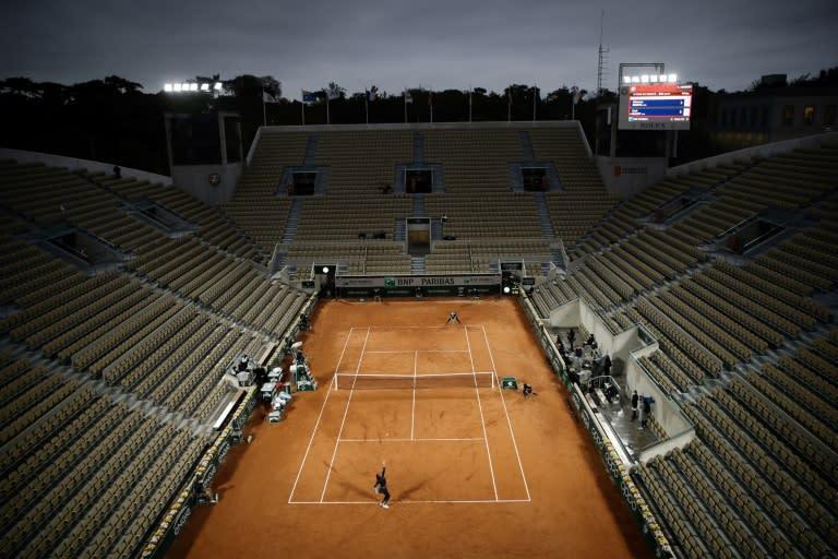 Empty feeling: Coco Gauff serves to Johanna Konta on a deserted Court Suzanne Lenglen