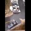 After husband forgets lunch, wife throws it from the BALCONY and INTO his car