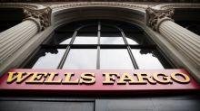 Wells Fargo profit up, faces possible $1 billion settlement