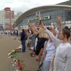 Women gather in Belarus capital to lay flowers for victims of police violence on protesters