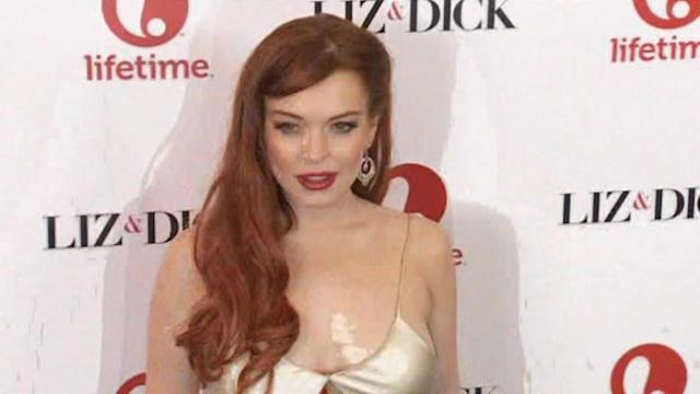 Lohan avoids Venice, Cage premieres there