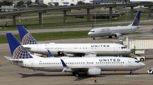 Hurricanes help push down United's 3Q profit by one-third