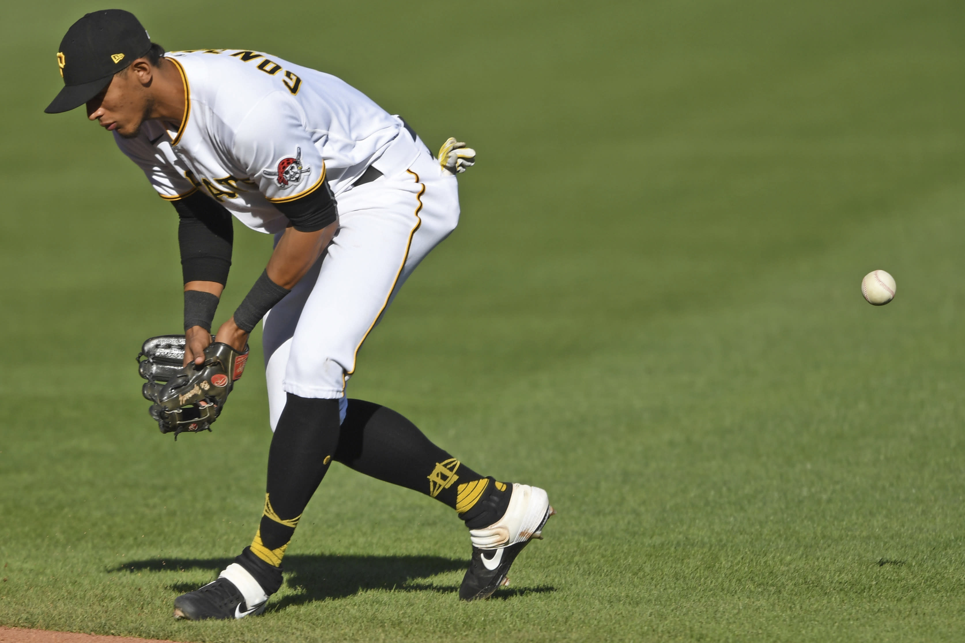 Pittsburgh Pirates' Erik Gonzalez misplays a ball hit by St. Louis Cardinals' Brad Miller during the fourth inning of a baseball game, Sunday, Sept. 20, 2020, in Pittsburgh. (AP Photo/David Dermer) Pennsylvania